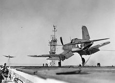 F4U-1 Corsair fighter of US Navy squadron VF-17 landing on USS Charger February 1943.
