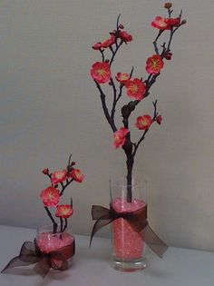 This one is kind of..... Lumpy, but I saw a cool idea where someone used string lights to make cherry blossom lights, and I like the way this one grows out of the base. Maybe more of a bonsai tree look? (Bonsai trees are typically made of juniper plants, because they grow quickly and gnarled.)