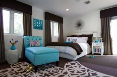 Fashionable Turquoise Bedroom Ideas | This turquoise chaise lounge is a perfect addition in this neutral bedroom design. It adds fun and elegance this retro-chic space.