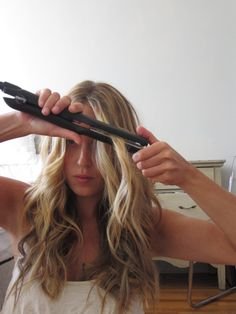 Wavy Hair Tutorial, with a flat iron. I tried this and it works so well!! I've been looking for ways to curl my hair while still having the smoothing benefits of a straightener. Win-win!