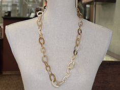 Horn light color links necklace.
