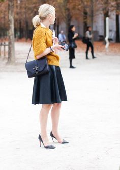 love the sweater colour and the + skirt look...is it leather? very feminine but not girlie