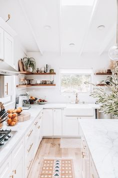cozy kitchen design // all white kitchen // white cabinets // floating shelves // open shelves // small kitchen design Cozy Kitchen, New Kitchen, Kitchen Decor, Kitchen White, Corner Shelves Kitchen, Small White Kitchens, Square Kitchen, Bright Kitchens, Home Kitchens