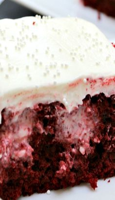 Red Velvet, or chocolate Poke Cake with cream cheese filling, and buttercream frosting.