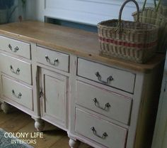 """Fabulous circa 1850 pine kitchen cupboard with 7 drawers and a """"Kennel"""" door pot cupboard with 6 bun feet. It is re-loved in Annie Sloan`s Chalk Paint Scandinavian Pink and Old Ochre waxed and distressed. An absolute gem which can work in any room of your home..top could be varnished if in high use ie kitchen or dining room. The top right drawer has been replaced at some point in its approx 160 year lifetime..handles have been cleaned up and shined.."""