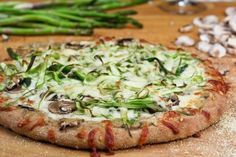 Shaved Asparagus and Mushroom Pizza at http://tastyshare.com/index.php/posts/158517-Shaved-Asparagus-and-Mushroom-Pizza