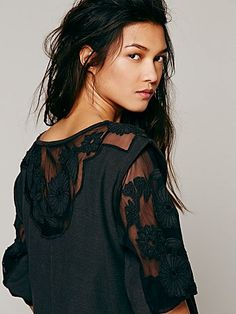 FP New Romantics Tropicali Tee | Soft cotton pullover with sheer panels on sleeves and neck featuring floral appliqués.  V-Neck.  Hi-Low hem and trim.  Raw trim.  *Dreamy fabrics, slubby textures, and ethereal sheer details come together to create New Romantics, a collection of pieces that are hand touched and hopelessly romantic.