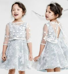 V-Hole Lace Dress---Made To Order - High Quality Beautiful Sleeveless Round Neckline Knee length Little Girl Lace Dress With V-Hole Back. Perfect gown for photo shoot, Christmas, wedding, birthday or any occasion. Available from 3 until 15 years old. Material: Cotton, soft polyester fiber, satin. Color: Blue Heather (Light blue & Light Gray). Please do compare your  little girl measurements with our size chart below before deciding her size or you may leave a note your little girl's height…