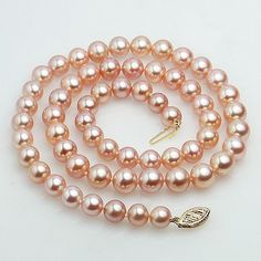 Simple pink pearl necklace, I'd want a 18 - 20 inch length, with matching dangly earrings that have a lever back.
