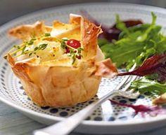 Das Rezept für Filoteig-Muffins mit Feta und Kirschtomaten und weitere kostenlose Rezepte auf LECKER.de