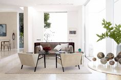 """Small Space Decorating - How To Decorate A Small Space - ELLE DECOR ET CREATIVE WITH FURNITURE PLACEMENT  Furniture placement can be tricky in a room without much wall space. In the family room, designer Chad Eisner pulled the furniture into the middle of the room and designed a screen that """"wraps"""" the sofa and anchors a desk behind it."""