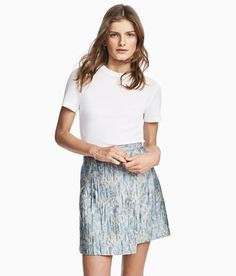 Check this out! Short jacquard-weave skirt with attached wrapover at front and concealed zip at back. Unlined. - Visit hm.com to see more.