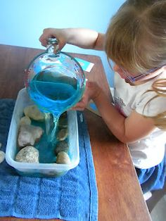 Montessori DIY Practical Life & Geography: land and water forms, blue tint water. Maybe use clay to mold landforms? I need a sand/ water table:)