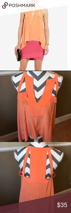 BCBG Maxazria Kayleen Tangelo Orange Top S Kayleen Tangelo Orange in size S Material 100% Silk has a very small little imperfection on the front part of V cut of top. Shown on last pic. Hardly worn in great condition BCBGMaxAzria Tops Camisoles