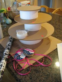 Make Your Own Cupcake Stand: Cake boards, Cake forms, Decorative paper (wrapping, contact, etc), Ribbon & hot glue