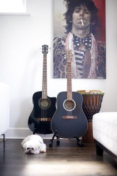 """Guitar display, my boyfriends loves the Keith Richards poster in the background. """"Screw the guitars, I want the Keith Richards poster"""" *kick*kick*"""