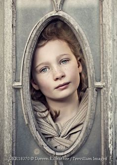 Trevillion Images - girl-looking-through-frame