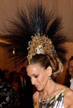 Not one to be outshined, ever, in the wardrobe department — Sarah Jessica Parker took her look to the next level with a feathered mohawk.