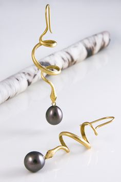 Gabriella Kiss 18k spiral snakes with South Sea pearls....LOVE!   #snakes #jewelry_trend