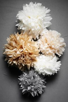 Paper flowers. Super cute to do a small accent wall of these, especially for a nursery.