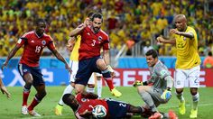 FORTALEZA, BRAZIL - JULY 04: Mario Yepes of Colombia attempts to shoot against Julio Cesar of Brazil during the 2014 FIFA World Cup Brazil Quarter Final match between Brazil and Colombia at Castelao on July 4, 2014 in Fortaleza, Brazil. (Photo by Jamie McDonald/Getty Images)  2014 FIFA World Cup Brazil™: Brazil-Colombia - Photos - FIFA.com