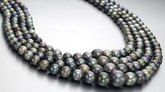 A four-strand natural colored pearl necklace measuring from 12.65 to 4.90 mm.