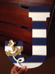Alicia's baby boy shower 10/3/15: DIY painted nautical wooden letter with anchor, rope, and ribbon.