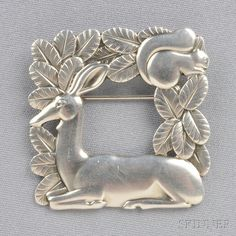 Sterling Silver Brooch, Georg Jensen, depicting a doe and squirrel, no. 318, lg. 1 1/2 in., signed Georg Jensen, Denmark.
