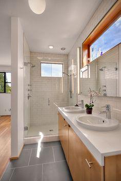 basic dark grey floor, subway tile shower, high windows with mirror below