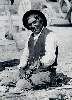 This photo of Wovoka was taken long after the Ghost Dance.  Holding snake.
