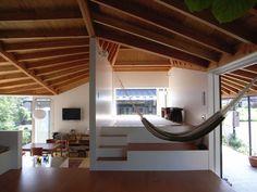 Airy indoor hammock space.