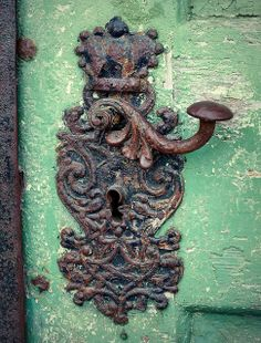 Antique wrought iron door handle and lock on the Royal Palace of Gödöllő, Hungary. Door handle on main door of the church Photo:  Elinor04, Budapest  via: Flickr