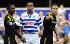 Queens Park Rangers' English defender Anton Ferdinand (2nd L) waits with Chelsea's English defender John Terry (R) during the English Premier League football match between Queens Park Rangers and Chelsea at Loftus Road in London, England on September 15, 2012