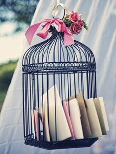 "Love the idea of hanging a vintage looking birdcage over the ""guestbook"" table for guests to put cards.  Saves space, and looks fancy^^."