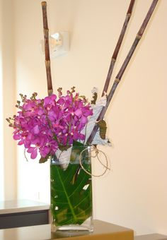 This is a floral arrangement that features pink mokara orchids.