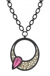 Striking color contrast in this sleek pendant.