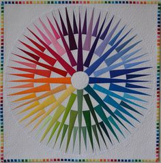 There's so much going on here in this Rainbow Compass Mini Quilt by Jen Johnston.
