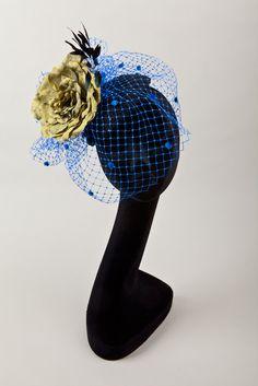 Black fascinator/cocktail hat with large blue/green silk rose & electic blue veiling. $160.00, via Etsy.
