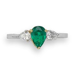 An emerald and diamond three stone ring, the pear cut emerald centre stone, claw set in yellow gold between pear cut diamond side stones, combined weight ct, to an white gold shank Emerald Diamond, Sapphire, Three Stone Rings, Shank, Turquoise Bracelet, Pear, Jewerly, Centre, White Gold