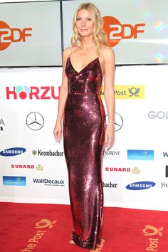 GWYNETH PALTROW Leaving her favorite plunging styles at home, the star dazzles in a fully sequined reddish-pink Prada gown at the Golden Camera Awards in Berlin, Germany. Celebrity Red Carpet, Celebrity Dresses, Celebrity Style, Gwyneth Paltrow, Jessica Chastain, Jessica Biel, Evening Dresses, Prom Dresses, Sparkly Dresses