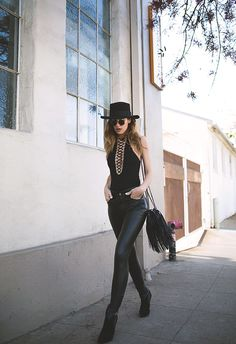 Native Fox (Hat - Saint Laurent, Sunglasses - Ray-Ban, Bodysuit - Givenchy,  Bag - Chanel, Pants - Saint Laurent, Boots - Saint Laurent)
