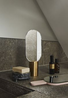 The Renga Hand Mirror is characterized by a simple and luxurious design, and it is both ideal to place on a table or a shelf or to use as a portable mirror. Standing Mirror, Bath Design, Bathroom Interior Design, Bathroom Accessories, Candle Sconces, A Table, Wall Lights, Plating, Room Decor