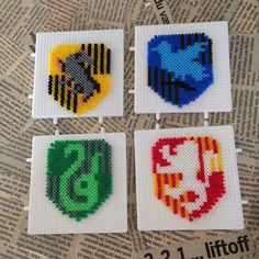 Harry potter crests hama beads by pernille horup perler bead Melty Bead Patterns, Pearler Bead Patterns, Perler Patterns, Beading Patterns, Harry Potter Crest, Deco Harry Potter, Theme Harry Potter, Hamma Beads 3d, Peler Beads