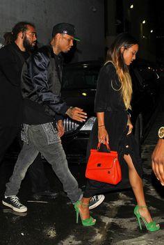 Chris Brown & Karruche Tran - BET Awards.   Green Heels + Black Dress + Red bag = FASHION