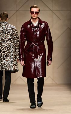 82109fb3b17 Oxblood laminated cotton trench coat and animal print iPhone case on the  runway of the Burberry