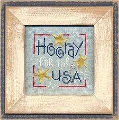 """""""Hooray for the USA"""" is the title of this cross stitch pattern from Lizzie Kate that is stitched with Gentle Art Sampler threads (Buckeye Scarlet and Midnight) and Weeks Dye Works (Curry and Snowflake) or with DMC equivalents provided."""