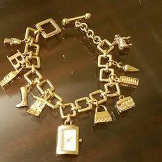Burberry Gold tone Charm Bracelet Beautiful charm bracelet with watch. Watch needs battery! Includes box. Burberry Jewelry Bracelets