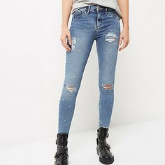 Authentic blue wash denim Distressed detailing Paint splatter effect Skinny fit Button fly fastening  Chewed hems