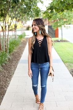 Black lace up tank top. Pop of colors with earrings.