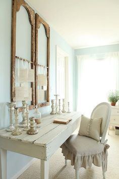 So...shabby chic--I do love it.  It looks so lovely with the mint green walls and muslin, silver and glass.  Still, I do worry that there's no place to hide, you know, STUFF.
